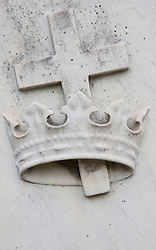 crown and cross found on a gravestone