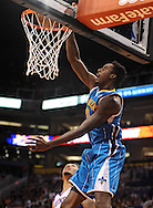 Nov. 23, 2012; Phoenix, AZ, USA; New Orleans Hornets forward Al-Farouq Aminu (0) dunks the ball during the game against the Phoenix Suns in the first half at US Airways Center. Mandatory Credit: Jennifer Stewart-US PRESSWIRE.