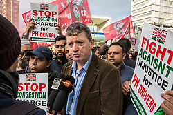 London, UK. 14th January, 2019. James Farrar, Chair of the Independent Workers Union of Great Britain's United Private Hire Drivers branch, is interviewed as minicab drivers take part in a protest outside the offices of Transport for London organised by the IWGB UPHD  following the introduction last month of congestion charges for minicabs.