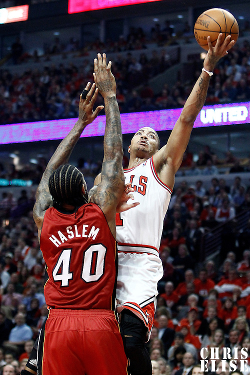 18 May 2011: Chicago Bulls point guard Derrick Rose (1) goes for the lay up past Miami Heat power forward Udonis Haslem (40) during the Miami Heat 85-75 victory over the Chicago Bulls, during game 2 of the Eastern Conference finals at the United Center, Chicago, Illinois, USA.