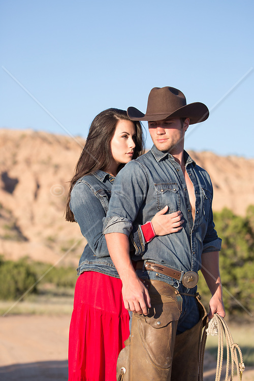 romantic cowboy and a girl outdoors on a ranch