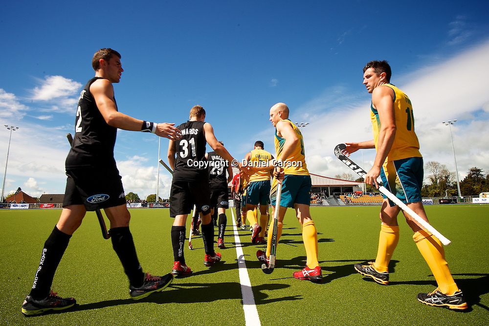 Cory Bennett of the New Zealand Black Sticks looks to shake hands with Russell Ford of Australia (Kookaburras) during the match from the Oceania Cup Hockey - Kookaburras v Black Sticks Men, 1 November 2013. Photo: Daniel Carson | DCIMAGES.ORG   | photosport.co.nz