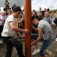 Conor Egan and Moriah Linneen try to plug all the leaks at the Kilmihil Festival of Fun at the weekend.<br /> Photograph by Yvonne Vaughan