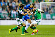 Stian Gregersen (#6) of Molde is challenged by Martin Boyle (#10) of Hibernian and Lewis Stevenson (#16) of Hibernian during the Europa League match between Hibernian and Molde FK at Easter Road, Edinburgh, Scotland on 9 August 2018.