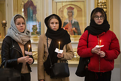 April 5, 2017 - Saint Petersburg, Russia - People hold candles as they attend a funeral service for victims of the St Petersburg Metro explosion, in Saint Petersburg, Russia, on April 5, 2017. (Credit Image: © Igor Russak/NurPhoto via ZUMA Press)