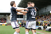 Brentford forward Sergi Canos (47) scores a goal 1-0 and celebrates with Brentford forward Lasse Vibe (21), Brentford midfielder Jota (23) during the EFL Sky Bet Championship match between Burton Albion and Brentford at the Pirelli Stadium, Burton upon Trent, England on 18 March 2017. Photo by Richard Holmes.