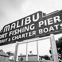 Malibu Sign Sport Fishing Pier black and white picture. The famous Malibu sign is along Pacific Coast Highway in Southern California in the United States.