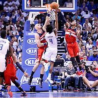 28 October 2015: Orlando Magic guard Elfrid Payton (4) is blocked by Washington Wizards guard John Wall (2) during the Washington Wizards 88-87 victory over the Orlando Magic, at the Amway Center, in Orlando, Florida, USA.