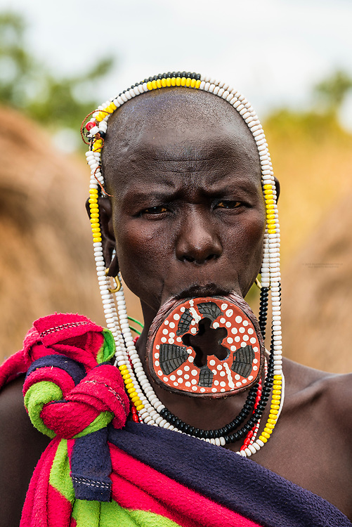 Mursi tribe woman, Mago National Park, Omo Valley, Ethiopia. The women have modified their lips and ears to wear clay discs.