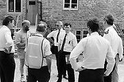 Michael Eavis in discussion with fire officers safety team. Glastonbury, Somerset,1989.