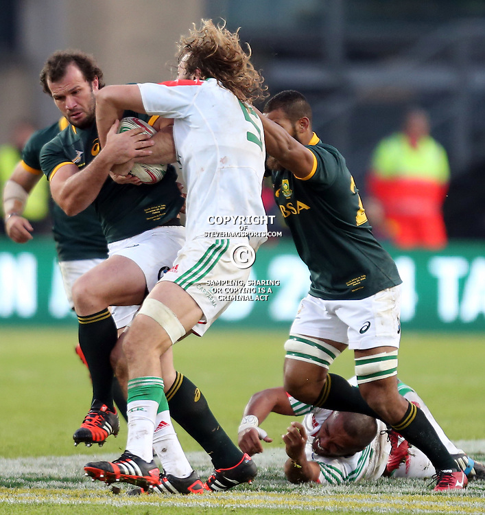 PADUA, ITALY - NOVEMBER 22: Bismarck du Plessis of South Africa taking the ball away from Joshua Furno of Italy during the Castle Lager Outgoing Tour match between Italy and South African at Stadio Euganeo on November 22, 2014 in Padua, Italy. (Photo by Steve Haag/Gallo Images)
