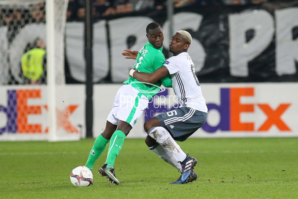 Saint-Etienne Midfielder Henri Saivet battles with Paul Pogba Midfielder of Manchester United during the Europa League match between Saint-Etienne and Manchester United at Stade Geoffroy Guichard, Saint-Etienne, France on 22 February 2017. Photo by Phil Duncan.