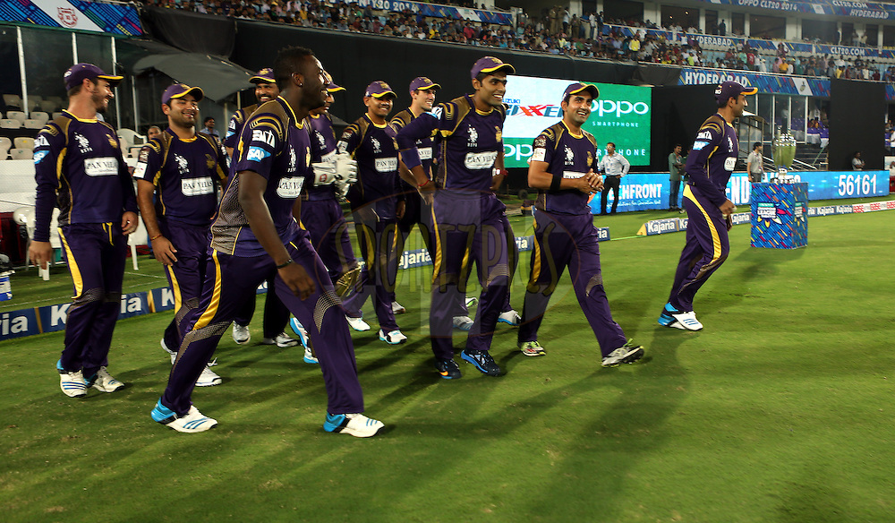 Players of Kolkatta Knight Riders run to take the feild  during match 7 of the Oppo Champions League Twenty20 between the Kolkata Knight Riders and the Lahore Lions held at the Rajiv Gandhi Cricket Stadium, Hyderabad, India on the 21st September 2014<br /> <br /> Photo by:  Sandeep Shetty / Sportzpics/ CLT20<br /> <br /> <br /> Image use is subject to the terms and conditions as laid out by the BCCI/ CLT20.  The terms and conditions can be downloaded here:<br /> <br /> http://sportzpics.photoshelter.com/gallery/CLT20-Image-Terms-and-Conditions-2014/G0000IfNJn535VPU/C0000QhhKadWcjYs