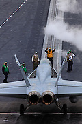 A Boeing F/A-18C Hornet, AC 301 165187 from VFA-37 'Bulls' prepares for a cat shot on the deck of CVN-75 USS Harry S. Truman.