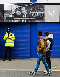 Everton fans stop to take a look at the Howard Kendall banner on the wall of Goodison Park - Mandatory byline: Matt McNulty/JMP - 07966 386802 - 17/10/2015 - FOOTBALL - Goodison Park - Liverpool, England - Everton v Manchester United - Barclays Premier League