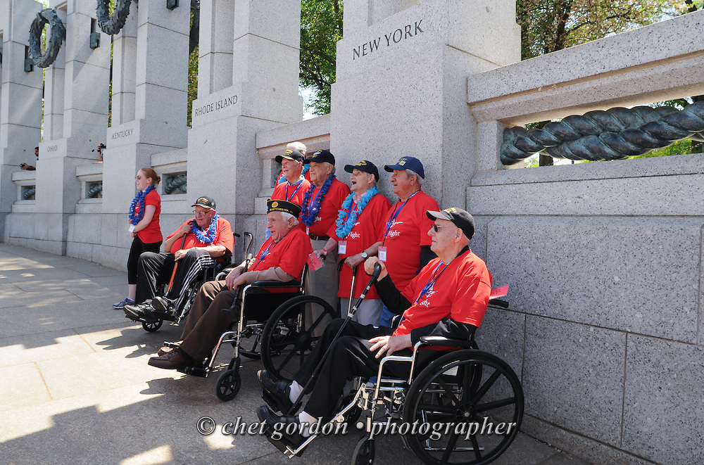 WWII Veterans and their escorts onboard the Hudson Valley Honor Flight at the WWII Memorial in Washington, DC on Saturday, May 9, 2015. Sixty-six veterans from the Westchester County (NY) area toured the WWII and Marine Corps War Memorials, as well as Arlington National Cemetery. Hudson Valley Honor Flight is a chapter of the Honor Flight Network, which provides free flights for WWII Veterans and tours of the WWII Memorial constructed in their honor, and other sites in the nation's capital.  © Chet Gordon / Hudson Valley Honor Flight