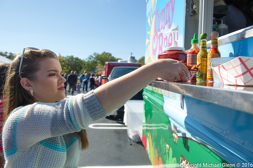 15 Oct. 2016 Forked River USA / Caitlin gets some fries at one of 5 food trucks that were available as St Pius X celebrates it's 10th year in their new church with a festival open to all  /  Michael Glenn  / Glenn Images