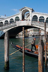 The famous historic Rialto Bridge crossing the Grand Canal in Venice Itlay