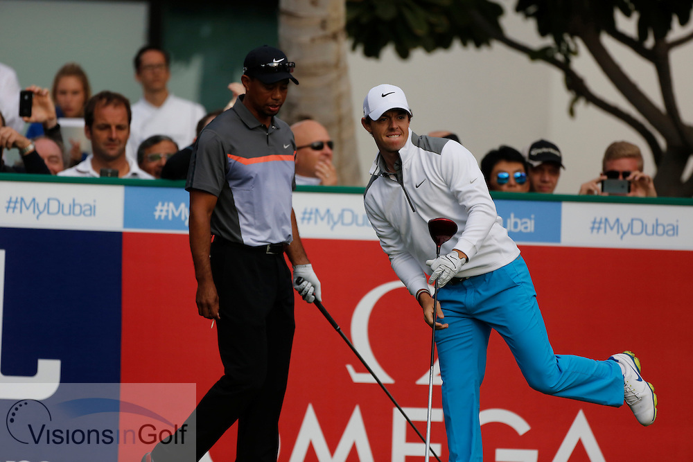 Rory McIlroy and Tiger Woods<br /> Omega Dubai Desert Classic, Emirates GC, UAE, January 2014<br /> Picture Credit:  Mark Newcombe / www.visionsingolf.com