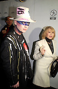Boy George and Connie Fillipani, Xelibri mobile phone launch, Old Billingsgate Market, 15 February 2003. © Copyright Photograph by Dafydd Jones 66 Stockwell Park Rd. London SW9 0DA Tel 020 7733 0108 www.dafjones.com