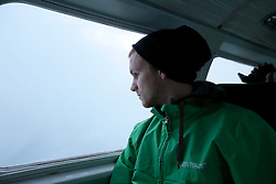 NORWAY BARENTS SEA 6DEC15 - Greenpeace campaigner Erlend Tellnes of Norwayduring the surveys flight to the production platform Goliat in the Barents Sea operated by Italian energy compay Eni. It is the world's most northerly oil production platform.<br /> <br /> jre/Photo by Jiri Rezac / Greenpeace<br /> <br /> © Jiri Rezac 2015