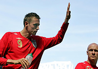 "Photo: Paul Thomas.<br /> England v Jamaica. International Friendly. 03/06/2006.<br /> <br /> Peter Crouch leaves the field with a ""hat-trick"" of goals."