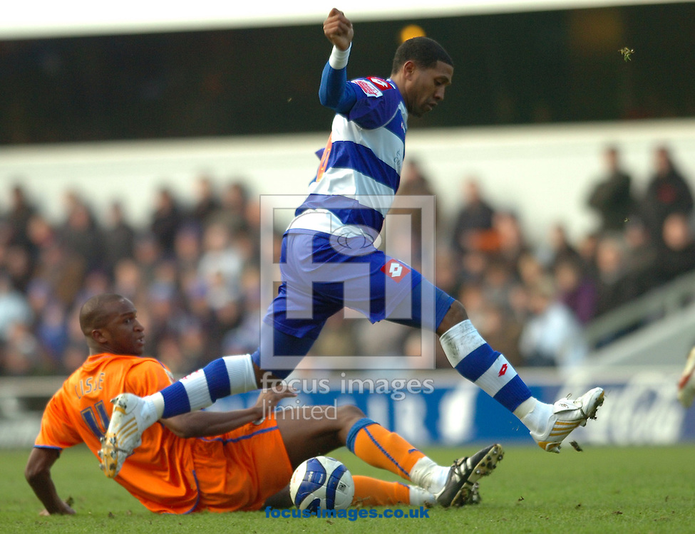 London - Saturday January 31st, 2009: Mikele Leigertwood of QPR in action against Kalifa Cisse of Reading during the Coca Cola Championship match at Loftus Road, London. (Pic by Focus Images)