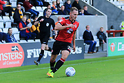 Adam McGurk of Morecambe runs with the ball during the EFL Sky Bet League 2 match between Morecambe and Newport County at the Globe Arena, Morecambe, England on 16 September 2017. Photo by Mick Haynes.