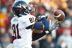November 20, 2010; Chestnut Hill, MA, USA;  Boston College Eagles linebacker Luke Kuechly (back) breaks up a hail mary pass intended for Virginia Cavaliers wide receiver Dontrelle Inman (81) to end the game at Alumni Stadium.  Boston College defeated Virginia 17-13.