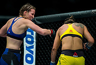 Leslie Smith (Blue) in action against Amanda Lemos in their bantamweight bout during the UFC Fight Night at the SSE Hyrdo, Glasgow. PRESS ASSOCIATION Photo. Picture date: Sunday July 16, 2017. See PA story SPORT UFC. Photo credit should read: Craig Watson/PA Wire.