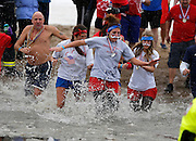 Participants enter the water at the 14th Annual Polar Bear Plunge at Ontario Beach Park on Sunday, February 9, 2014.