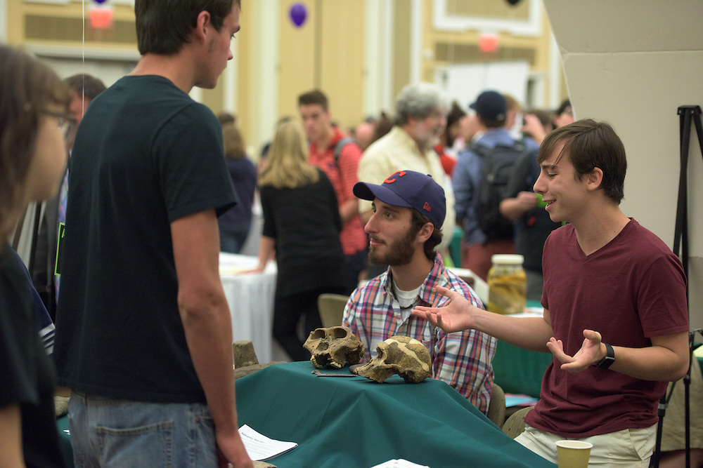 Jacob Ballas, right, and Patrick Fahey speak with prospective students at the Anthropology booth during the 2016 Ohio University Majors Fair held at the Baker Center Ballroom on Wednesday, September 14, 2016.