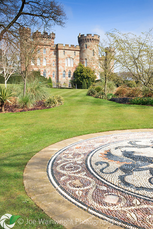Photographed from its beautiful gardens, Cholmondeley Castle was built between 1817 and 1819.  Unlike the gardens, it is not open to the public.  The mosaic (pictured) was comissioned by the Dowager Marchioness of Cholmondeley as a memorial to her husband.