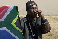 Selling flags for fans of South Africa and Mexico when they arrive for the Opening Ceremony ahead of the 2010 FIFA World Cup South Africa Group A match between South Africa and Mexico at Soccer City Stadium on June 11, 2010 in Johannesburg, South Africa.  (Photo by Vid Ponikvar / Sportida)