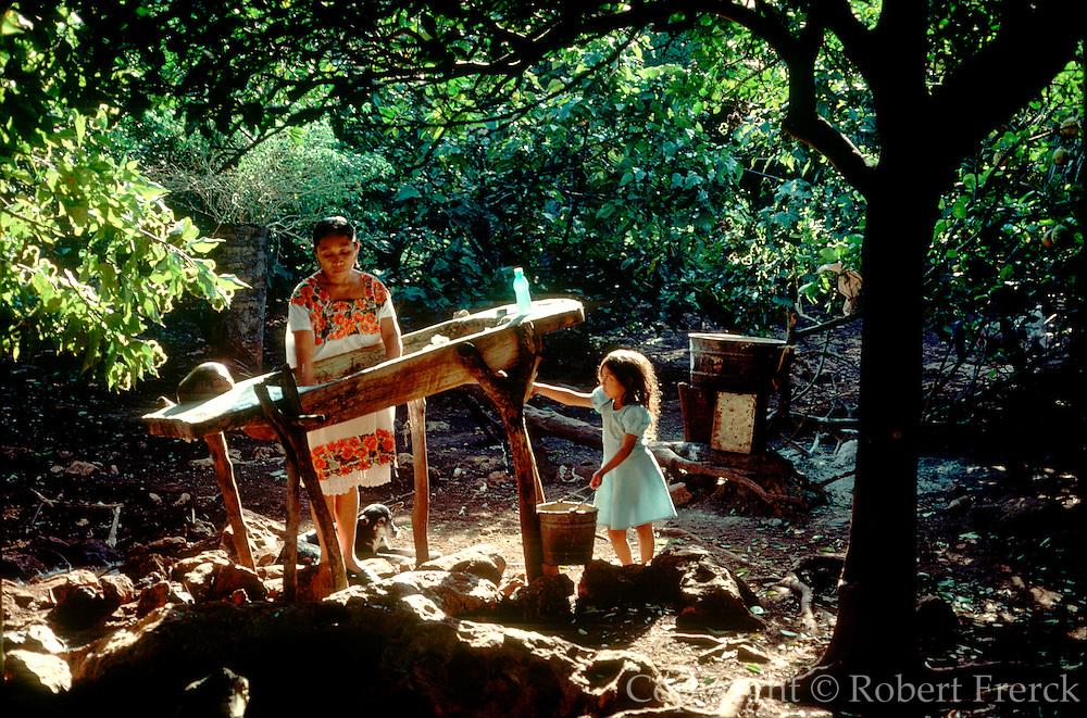 MEXICO, YUCATAN PENINSULA Mayan family washing clothes