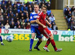 Bristol City's Brett Pitman flicks the ball past Reading's Alex Pearce - Photo mandatory by-line: Joe Meredith/JMP - 26/12/2010 - SPORT - FOOTBALL - Championship - Reading v Bristol City  - Madejski Stadium, Reading, England