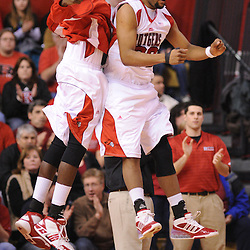Jan 31, 2009; Piscataway, NJ, USA; Rutgers forward Gregory Echenique (00) chest-bumps teammate center Hamady N'Diaye (5) during player introductions before Rutgers' 75-56 victory over DePaul in NCAA college basketball at the Louis Brown Athletic Center