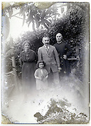 eroding glass plate with family and priest
