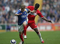 Photo: Lee Earle.<br /> Portsmouth v Middlesbrough. The Barclays Premiership. 15/04/2006. Pompey's Andres D'Alessandro (L) battles with George Boateng.