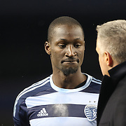 Peter Vermes, Head Coach of Sporting Kansas City, talks with defender Ike Opara after his sides 1-0 victory during the New York City FC Vs Sporting Kansas City, MSL regular season football match at Yankee Stadium, The Bronx, New York,  USA. 27th March 2015. Photo Tim Clayton
