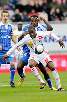 FOOTBALL - FRENCH CHAMPIONSHIP 2009/2010 - L1 - AS NANCY v AJ AUXERRE - 11/04/2010 - PHOTO GUILLAUME RAMON / DPPI -<br /> CHRIS MALONGA (NANCY)  AND DENNIS OLIECH (AUXERRE)
