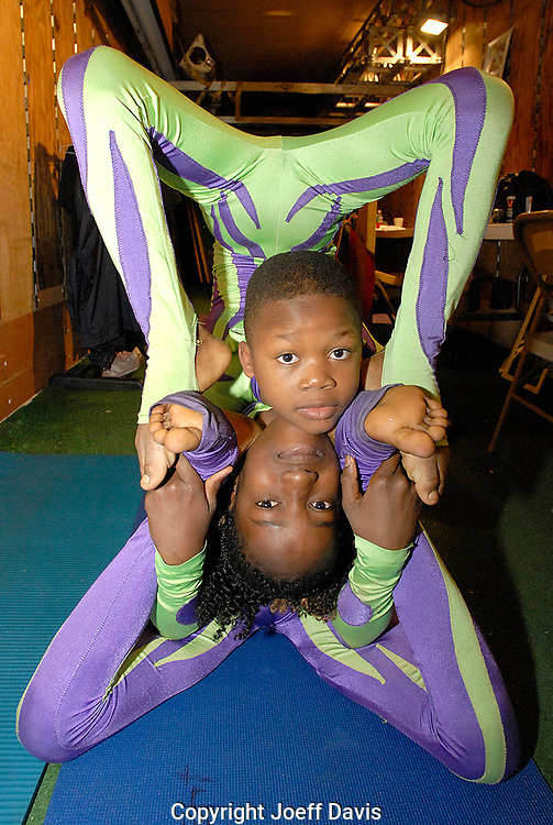 The UniverSoul Circus contortionists warm up in there trailer in the Turner Field parking lot before a performance, February 20, 2008 in Atlanta, Georgia.