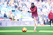 Ainsley Maitland-Niles of Arsenal (15) warming up during the Premier League match between Huddersfield Town and Arsenal at the John Smiths Stadium, Huddersfield, England on 9 February 2019.