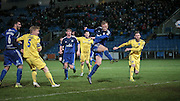 Jordan Burrow (Halifax) flashes a shot in on goal that goes just past the post having beat Steve Drench (Guiseley) during the Conference Premier League match between FC Halifax Town and Guiseley at the Shay, Halifax, United Kingdom on 5 December 2015. Photo by Mark P Doherty.