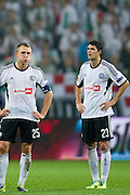(L) Legia's Jakub Rzezniczak and (R) Legia's Helio Pinto react after lost game at the UEFA Europa League Group J football match between Legia Warsaw and Trabzonspor AS at Pepsi Arena Stadium in Warsaw on November 07, 2013.<br /> <br /> Poland, Warsaw, November 07, 2013<br /> <br /> Picture also available in RAW (NEF) or TIFF format on special request.<br /> <br /> For editorial use only. Any commercial or promotional use requires permission.<br /> <br /> Mandatory credit:<br /> Photo by &copy; Adam Nurkiewicz / Mediasport