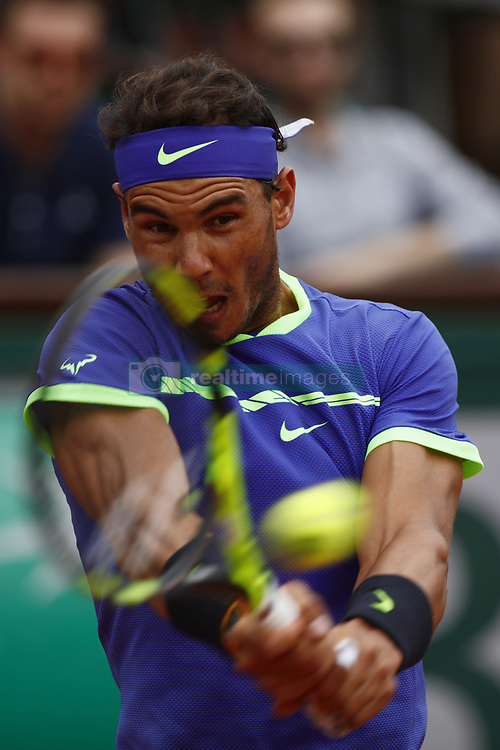 June 2, 2017 - Paris, France - Spain's Rafael Nadal returns the ball to Georgia's Nikoloz Basilashvili during their tennis match at the Roland Garros 2017 French Open on June 2, 2017 in Paris. (Credit Image: © Mehdi Taamallah/NurPhoto via ZUMA Press)