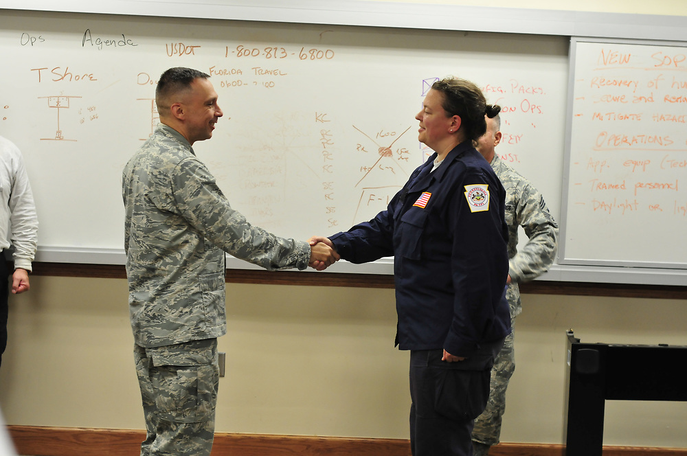 Medical Team Manager for Pennsylvania Task Force 1, physician Wendy Wilcoxson receives a impromptu military promotion ceremony durring her response to Hurricane Irma on Monday, Sept. 11, 2017 at Robins Air Force Base in Warner Robins, Georgia. Wilcoxsan is a United States Air Force Reserve Lt. Col with the 459th ASTS located at Joint Base Andrews in Maryland. Photo By | CHRIS POST FEMA PA TF-1