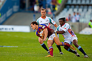 Ben Smith is tackled by Jonki Nokwe during the Super 14 match between the Cheetahs and the Highlanders at Vodacom Park in Bloemfontein, on the 27 February 2010.Photo by: Hilton Kotze/SPORTZPICS