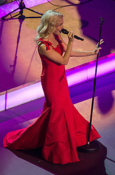 © London News Pictures. Pictured: Pixie Lott performs at The Royal Albert Hall, London during the Festival of Remembrance on Saturday 7th November 2015.. Photo credit: Rupert Frere/LNP