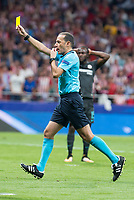Referee shows yellow card during UEFA Champions League match between Atletico de Madrid and Chelsea at Wanda Metropolitano in Madrid, Spain September 27, 2017. (ALTERPHOTOS/Borja B.Hojas)